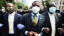 Members of Alpha Phi Alpha Fraternity march in New York after a memorial service for George Floyd this past summer. The fraternity is among among the groups leading campaigns to educate Black people about the vaccine.