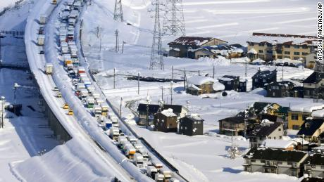 An aerial photo shows cars stuck on Kanetsu expressway in Minami-uonuma City, Niigata Prefecture on December. 18, 2020.