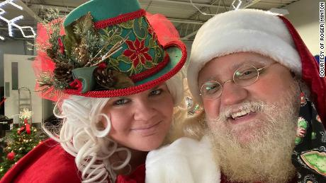 Roger Minton as Santa Claus and wife Erica Minton as Mrs. Claus.