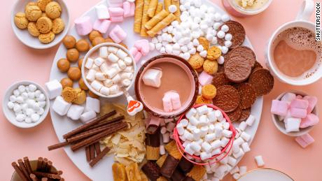 A hot chocolate board is a festive way to round out a low-key Christmas celebration.
