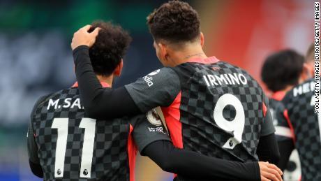 Roberto Firminho celebrates with Mo Salah after Liverpool's fifth goal.