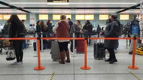 Passengers queue at Gatwick Airport in West Sussex.