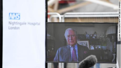 "Prince Charles is seen on a monitor as he speaks during the opening of the ""NHS Nightingale"" field hospital, at the ExCeL London exhibition center, in London on April 3."