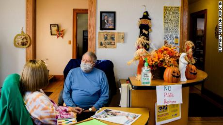 """""""When people find out there is a need, they will help each other,"""" said Mark Morand, pictured with volunteer Nancy McFarland at the Our Lady of Peace Catholic Parish St. Vincent DePaul Food Pantry in Bay City, Michigan, in October."""