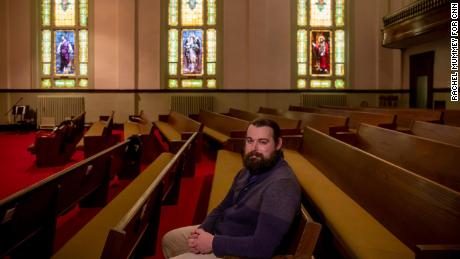 """""""The pandemic will pass, the contentious election atmosphere will pass,"""" said Pastor Luke Fillmore, pictured here at the United Methodist Church in Hamburg, Iowa, in January."""
