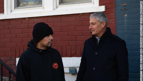 """""""If you want our power in two years, you have to keep coming around,"""" said Allentown activist Jose Rivera, pictured here with developer J.B. Reilly outside Rivera's investment property in December."""