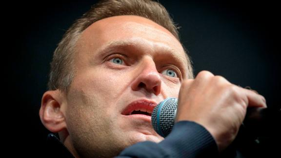 "Russian opposition leader Alexei Navalny delivers a speech during a demonstration in Moscow on September 29, 2019. - Thousands gathered in Moscow for a demonstration demanding the release of the opposition protesters prosecuted in recent months. Police estimated a turnout of 20,000 people at the Sakharov Avenue in central Moscow about half an hour after the start of the protest, which was authorised. The demonstrators chanted ""let them go"" and brandished placards demanding a halt to ""repressions"" of opposition protesters. (Photo by Yuri KADOBNOV / AFP) (Photo by YURI KADOBNOV/AFP via Getty Images)"