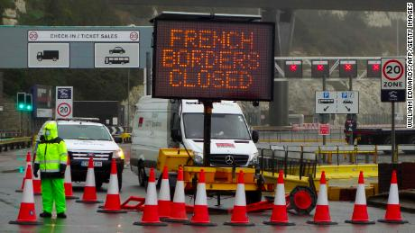 "A sign alerts customers that the ""French Borders are Closed"" at the entrance to the Port of Dover in Kent, south east England on December 21, 2020, as a string of countries banned travellers all but unaccompanied freight arriving from the UK, due to the rapid spread of a more-infectious new coronavirus strain. - Britain's critical south coast port at Dover said on Sunday it was closing to all accompanied freight and passengers due to the French border restrictions ""until further notice"". (Photo by William EDWARDS / AFP) (Photo by WILLIAM EDWARDS/AFP via Getty Images)"
