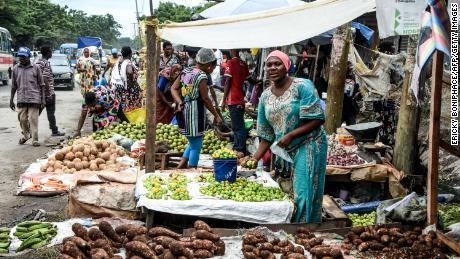 A vendor sells green peppers in Dar es Salaam, Tanzania, in April. According to the World Bank, poverty decreased more in Tanzania than any other country between 2000 and 2015.