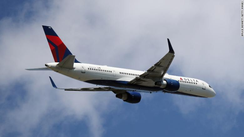 2 passengers open Delta flight cabin door and slide out moving plane with a dog at La Guardia
