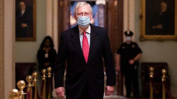 US Senate Majority Leader Mitch McConnell (C) walks near the Senate floor on Capitol Hill in Washington, DC, USA, 21 December 2020. United States congressional leaders are trying to pass a coronavirus stimulus and relief package worth approximately 900 billion US dollars. The COVID-19 stimulus relief package has been tied to a funding bill that would fund the government through September 2021.