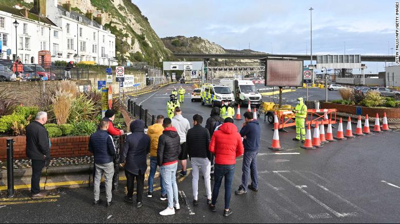 Trucks pile up in England as UK and France hold crisis talks to reopen border