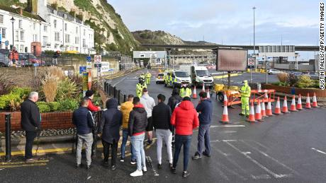 Drivers gather at the cordon blocking the entrance to the ferry terminal at the port of Dover in Kent, southeast England on Tuesday.