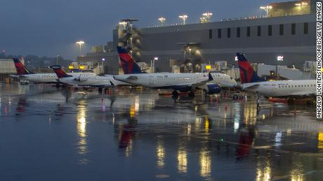 Planes line up at LaGuardia Airport's Delta Terminal in September.