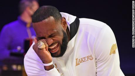 LeBron James reacts as he gets his 2019-20 NBA Championship ring during the ring ceremony.