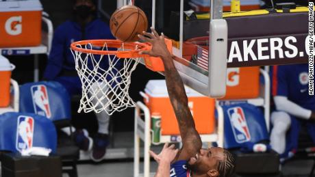 Kawhi Leonard dunks the ball against the Lakers.