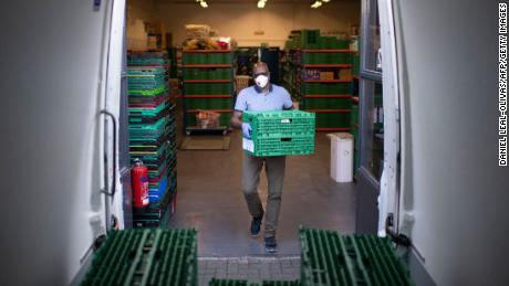 Co-founder and chair of the First Love foundation, Aerold Bentley loads crates packed with goods for distribution.