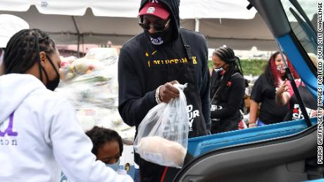 2 Chainz hosts a food drive in September in which volunteers handed out PPE and registered voters.