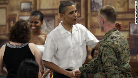 The Obamas during Christmas dinner at a Marine Corps base in Kaneohe, Hawaii, in 2010.