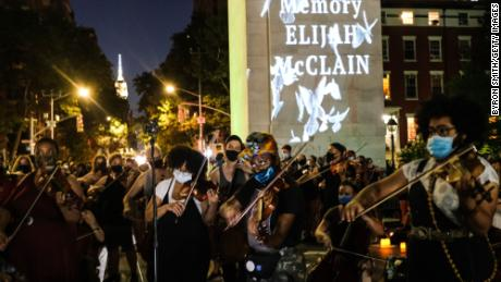 String players perform during a violin vigil for Elijah McClain in Washington Square Park on June 29, 2020 in New York City.
