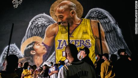Lakers fans stand in line to celebrate in front of a mural of Kobe Bryant and his daughter on October 11, 2020 in Los Angeles, California.