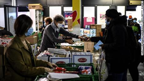 A volunteer at a Restos du Coeur center in Paris hands out food in October.