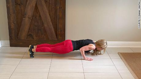 For proper push-up form, make sure your upper and lower body are straight to establish the plank position.