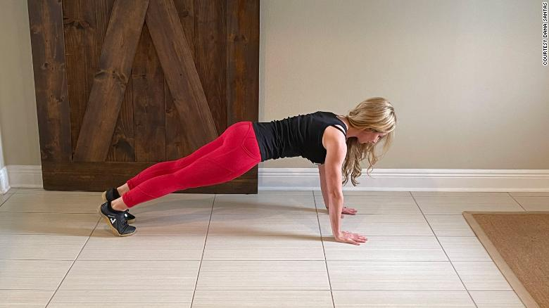 Fitness expert Dana Santas demonstrates a push-up, which builds upper body strength.