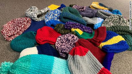 Toques made by the men in the knitting club.