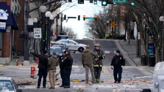 Emergency responders assess the damage near the scene.