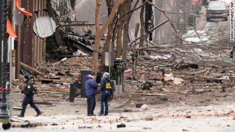 Emergency personnel work near the scene of an explosion in downtown Nashville on Dec. 25.
