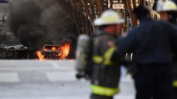 A vehicle burns following an explosion in downtown Nashville on Friday, December 25.