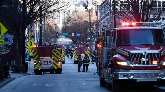 Firetrucks and emergency responders fill the streets following the explosion.