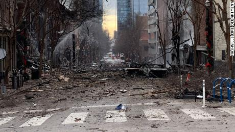 Burned cars and debris are seen on a street in downtown Nashville, Tennessee following an explosion on Dec. 25.
