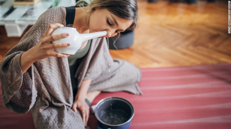 Using a well-maintained neti pot — no sharing — with sterilized water is another good option for safe removal of nose crusts.