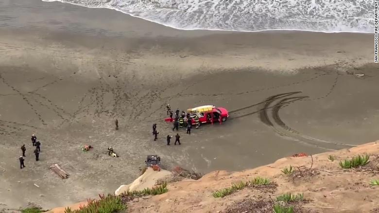 Woman rescued after car plunges off a cliff, landing on a San Francisco beach