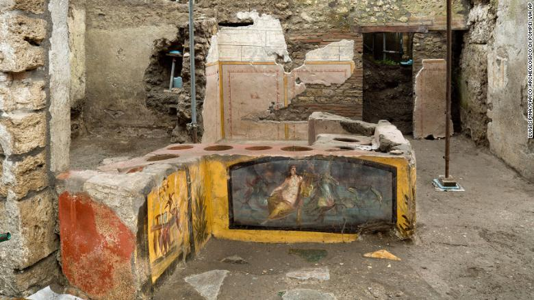 Ancient snack stall uncovered in Pompeii, revealing bright frescoes and traces of 2,000-year-old street food