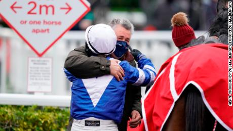 Bryony Frost gets a hug from trainer Paul Nicholls after riding Frodon to a brilliant victory in the King George VI Chase at Kempton Park on Boxing Day.