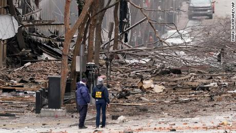 Emergency personnel work near the scene of the Nashville explosion Friday.