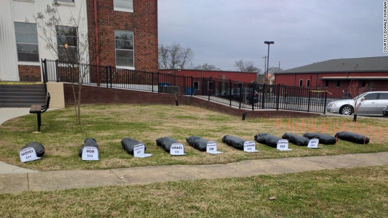 Group of Alabama protesters places fake body bags on courthouse lawn to push for removal of Confederate flag and monument