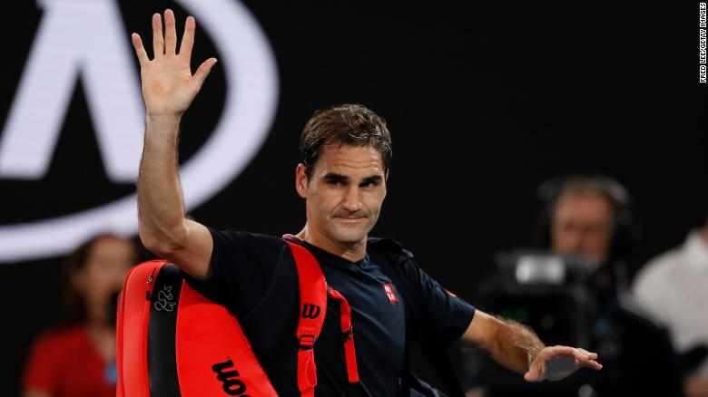 Federer acknowledges the crowd as he walks off court after losing against Djokovic at the Australian Open earlier this year.