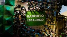 """Protesters hold a banner that reads, """"Legal Abortion,"""" outside the National Congress in Buenos Aires on December 10."""