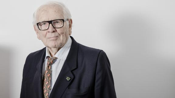 Pierre Cardin, owner and founder of Pierre Cardin, poses for a photograph following an interview in his office in Paris, France, on Monday, Dec. 19, 2016. Cardin's eponymous label has been for sale for a quarter of a century, though don't bother haggling over the price: the fashion designer who pioneered brand licensing won't entertain offers below 1 billion euros ($1.04 billion). Photographer: Marlene Awaad/Bloomberg via Getty Images