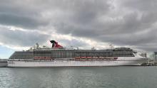 "The cruise ship ""Carnival Pride"" part of the Carnival Cruise Line is seen moored at a quay in the port of Miami."