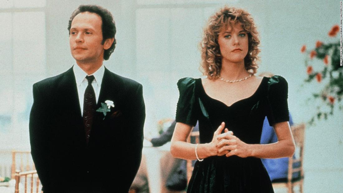 "Billy Crystal (left) and Meg Ryan (right) star in the 1989 romantic comedy ""When Harry Met Sally""; here they're shown in a wedding scene."
