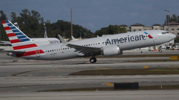 MIAMI, FLORIDA - DECEMBER 29: American Airlines flight 718, a Boeing 737 Max, takes off from Miami International Airport to New York on December 29, 2020 in Miami, Florida. The Boeing 737 Max flew its first commercial flight since the aircraft was allowed to return to service nearly two years after being grounded worldwide following a pair of separate crashes. (Photo by Joe Raedle/Getty Images)