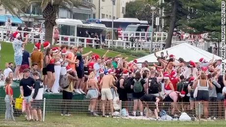 Sydney Beach Christmas Party Turns On 'Backpacker' Threat of Deportation From Australian Immigration Minister