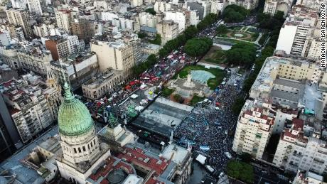 Abortion-rights activists, left, and activists against abortion, right, rally outside Argentina's Congress in the capitol of Buenos Aires as lawmakers debated a bill that would legalize abortion on Tuesday.