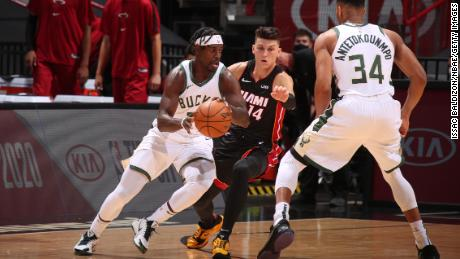 Jrue Holiday (left) led the Bucks in threes, making six of his 10 attempts.