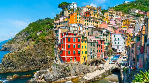Cinque Terre, Italy - july 1st 2020 - Overview of the village Riomaggiore with a very quiet square due to Corona, one of the towns known as Cinque Terre on a sunny Corona day in summer